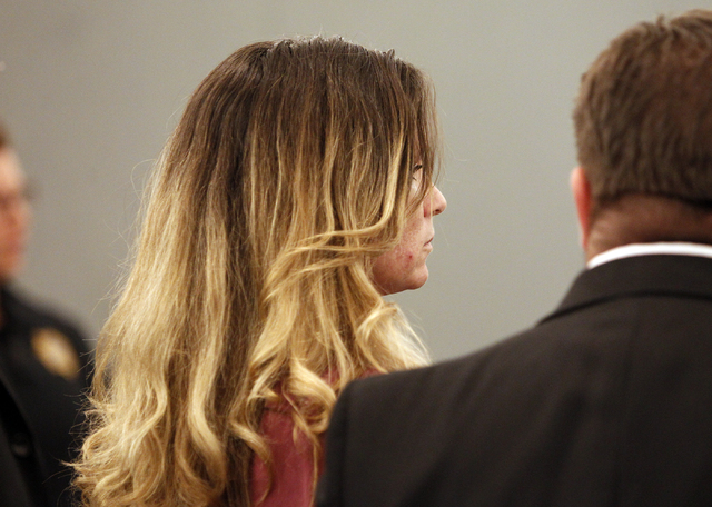 Amy Bessey listens to guilty verdicts for hiring her son and brother to kill her husband at the Regional Justice Center Tuesday, Nov. 26, 2013. Her estranged husband, Robert Bessey, was hit in the ...