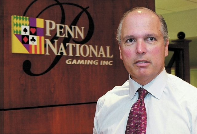 Peter Carlino, Chief Executive Officer of the Penn National Gaming Inc. company is shown at his Woymissing, Pa office Thursday, Aug. 29, 2002. Carlino is now completing an acquisition that will ma ...