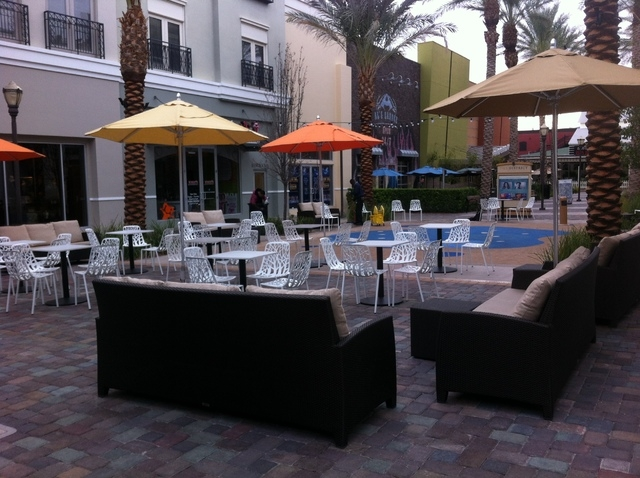 Patio seating, shown Monday, Nov. 4, 2013, at The District at Green Valley Ranch, is one of the many additions to the area. The District recently transformed its pedestrian walkway to allow two-la ...