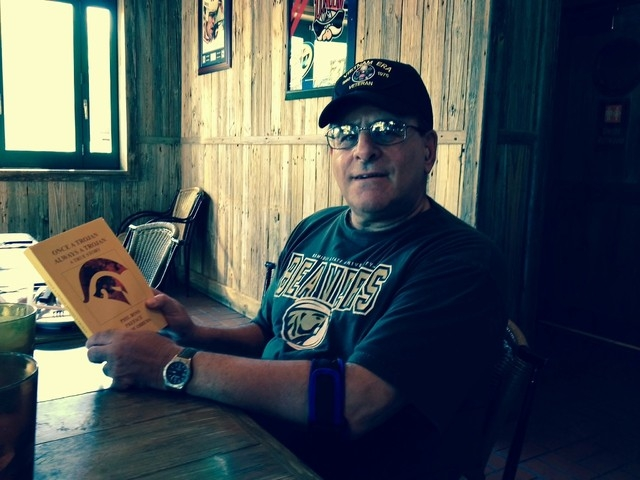 """Author Phil Ross holds a copy of his book """"Once a Trojan, Always a Trojan,"""" which chronicles the Southern California football team's national championship season of 1967. A chapter is devote ..."""