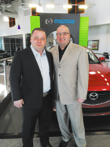 Courtesy photo  General Sales Managers Armen Sabondzhyan of Centennial Mazda and Tim Beyer of Planet Mazda