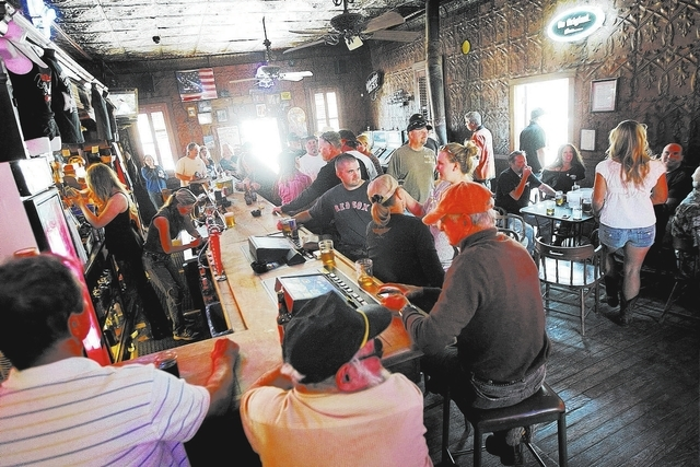 Patrons enjoy the atmosphere during the 100th birthday celebration for the Pioneer Saloon in Goodsprings on Oct. 19. (Jason Bean/Las Vegas Review-Journal)
