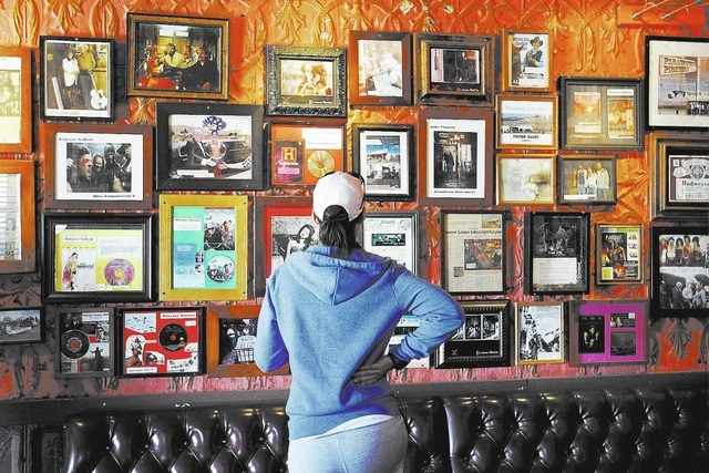 Cynthia Thomas examines some memorabilia during the 100th birthday celebration for the Pioneer Saloon in Goodsprings on Oct. 19, 2013. (Jason Bean/Las Vegas Review-Journal)