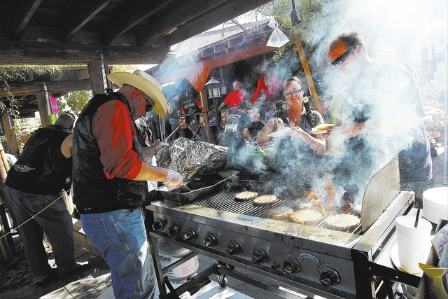 Saloon employee Geary Hewett, left, grills burgers for hungry patrons during the 100th birthday celebration for the Pioneer Saloon in Goodsprings on Oct. 19, 2013. (Jason Bean/Las Vegas Review-Jou ...