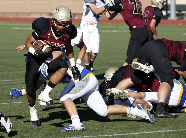Faith Lutheran player Keenan Smith runs for a touchdown against Lowry High School in the Division 1-A state semifinal football game at Faith Lutheran High School in Las Vegas Saturday, Nov. 16, 20 ...