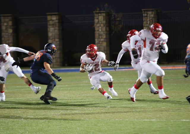 Arbor View tight end, Gage Motl (12), evades tacklers during the first quarter at the Sunset Region semifinal football game at Bishop Gorman High School on Friday, Nov. 22, 2013.  (Alex Federowicz ...
