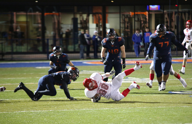 Arbor View tight end, Mitchell Durkee (88), goes down during the second quarter at the Sunset Region semifinal football game at Bishop Gorman High School on Friday, Nov. 22, 2013.  (Alex Federowic ...