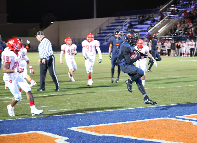 Bishop Gorman running back Daniel Stewart reaches the end zone on the first of his four touchdown runs Friday in the top-ranked Gaels' 52-7 win over Arbor View in a Division I Sunset Region semi ...