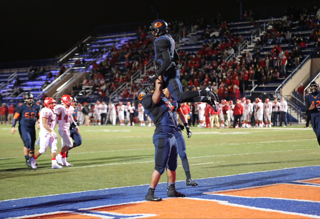 Bishop Gorman half back, Daniel Stewart (1), is given a congratulatory lift after scoring a touchdown during the second quarter at the Sunset Region semifinal football game at Bishop Gorman High S ...