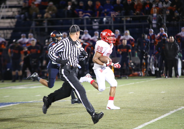 Arbor View running back, Jacob Speaks, outruns a Bishop Gorman defender during the second quarter at the Sunset Region semifinal football game at Bishop Gorman High School on Friday, Nov. 22, 2013 ...