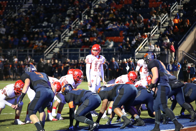 Arbor View quarterback, Andrew Cornwell (14), takes stock of his line before a play during the second quarter at the Sunset Region semifinal football game at Bishop Gorman High School on Friday, N ...
