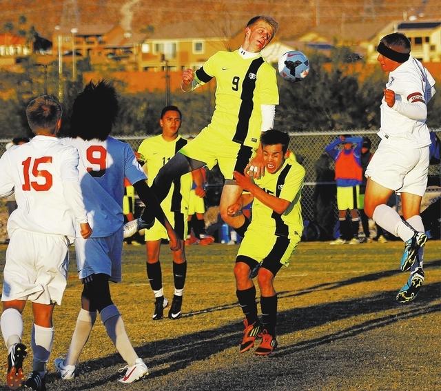 Green Valley's Kade Kochevar (9) attempts a header against Liberty during their quarterfinal soccer game at Heritage Park in Henderson on Nov. 5, 2013. (Jason Bean/Las Vegas Review-Journal)