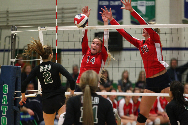 Coronado's Cali Thompson (14) and Berkeley Oblad (1) defend an attack from Palo Verde's Lexi Riggs (2) during the championship game of the Division I Girls Volleyball State Tournament at Green Val ...