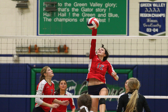Coronado's Brooke Garlick (12) hits the ball against Palo Verde during the championship game of the Division I Girls Volleyball State Tournament at Green Valley High School in Henderson on Saturda ...