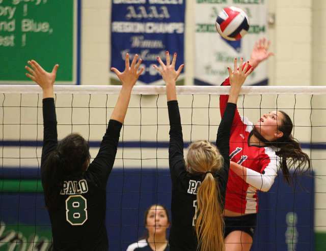 Coronado's Carolyn Andrulis (11) looks to strike against Palo Verde during the championship game of the Division I Girls Volleyball State Tournament at Green Valley High School in Henderson on Sat ...