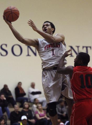Findlay Prep's Rashad Vaughn (1) soars to the basket past Planet Athlete's Reginald Norris (10) Wednesday in Henderson. (Jason Bean /Las Vegas Review-Journal)