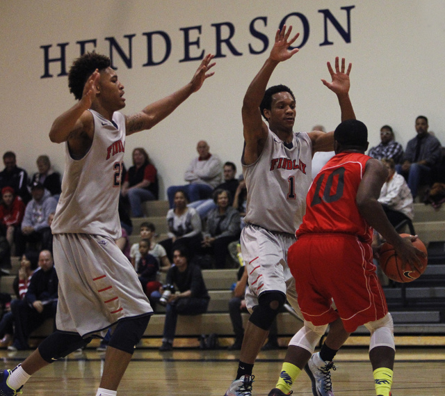 Findlay Prep's Rashad Vaughn (1) and Kelly Oubre Jr. (22) attempt to trap Planet Athlete's Reginald Norris (10) during a game in Henderson on Wednesday. (Jason Bean /Las Vegas Review-Journal)