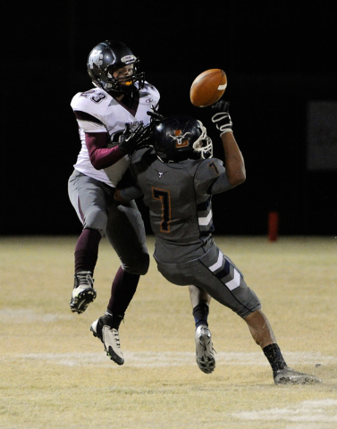 Legacy's Alvaro Sotelo (7) defends against Cimarron-Memorial's Djon Watson during the first half of a high school football game at Legacy High School on Friday, Nov. 1, 2013.  Sotelo was called fo ...