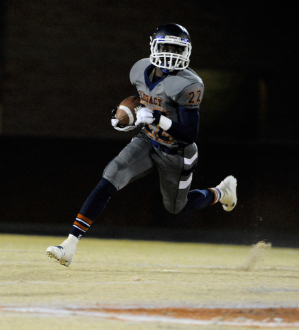 Legacy's DeMichael Walker runs with the ball during the first half of a high school football game against Cimarron-Memorial at Legacy High School on Friday, Nov. 1, 2013. (David Becker/Las Vegas R ...