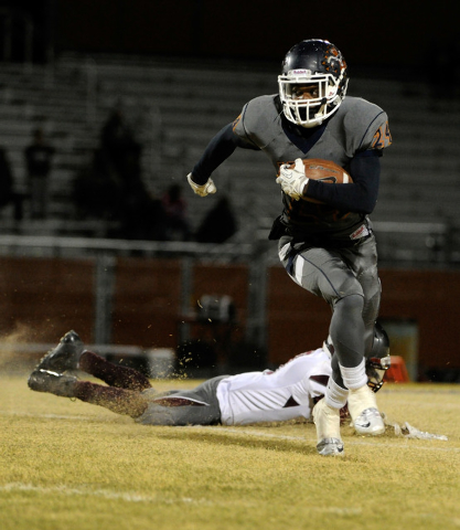 Legacy's Casey Hughes runs with the ball during a high school football game against Cimarron-Memorial at Legacy High School on Friday, Nov. 1, 2013. (David Becker/Las Vegas Review-Journal)