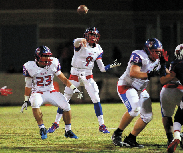 Liberty running back Tyler Parvin (23) blocks for quarterback Tyler Newman during the Patriots' 45-27 victory over Coronado on Oct. 4. Newman has completed 63.7 percent of his passes for 3,108 y ...