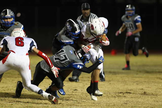 Coronado's Tanner Bellamy is taken down by Basic during a game at Basic High School in Henderson on Friday, Nov. 1, 2013. (Chase Stevens/Las Vegas Review-Journal)