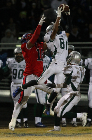 Green Valley's Kyle Parker (81) catches a pass while playing against Liberty during the Division I Sunrise Region championship game at Liberty High School in Henderson on Friday, Nov. 22, 2013. (C ...