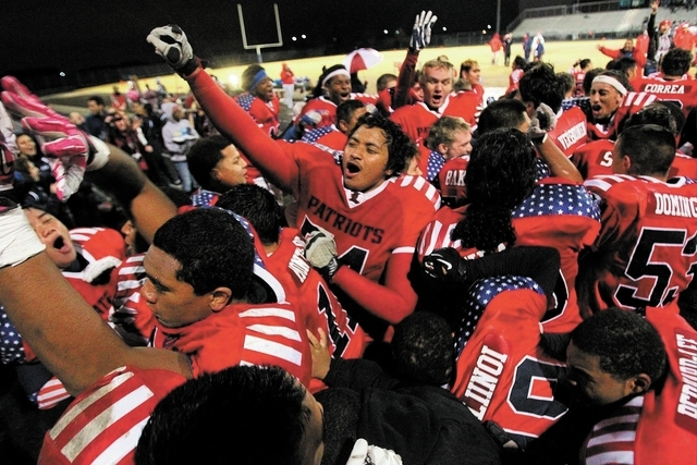 Liberty players celebrate on their home field after winning their fourth straight Sunrise Region championship Friday. (Chase Stevens/Las Vegas Review-Journal)