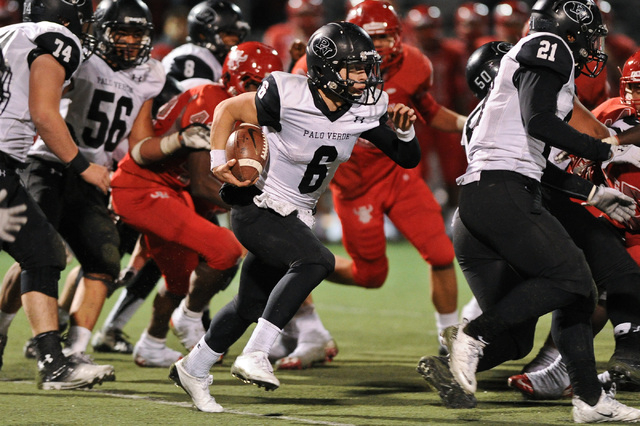 Palo Verde quarterback Parker Rost (6) looks for running room against the Arbor View defense during a football game at Arbor View High School in North Las Vegas, Nev. Friday, Nov. 8, 2013. (David  ...