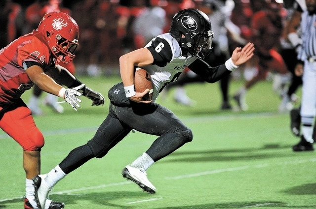 Palo Verde quarterback Parker Rost (6) breaks free from Arbor View defender Luke Thompson (41) for a touchdown score during a football game at Arbor View High School in North Las Vegas, Nev. Frida ...