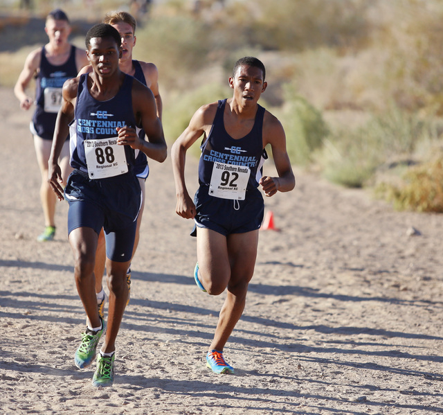 Centennial junior Dajour Braxton, left bib 88, and senior George Espino, right, bib 92, lead the Centennial pack during the Division 1 Sunset Boys track meet at Veterans Memorial Park Saturday, No ...