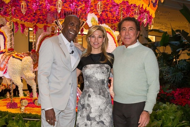 Event designer Preston Bailey, left, joins Steve and Andrea Wynn in the unveiling of the floral carousel at Wynn Las Vegas on Nov. 25. (Wynn Las Vegas photo)