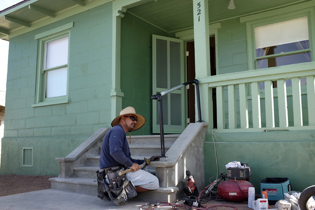 Joe Maturino installs a hand rail at  an old railroad cottage at the Clark County Museum in Henderson Thursday. The cottage was moved from Las Vegas to the museum and will be open to the public.   ...
