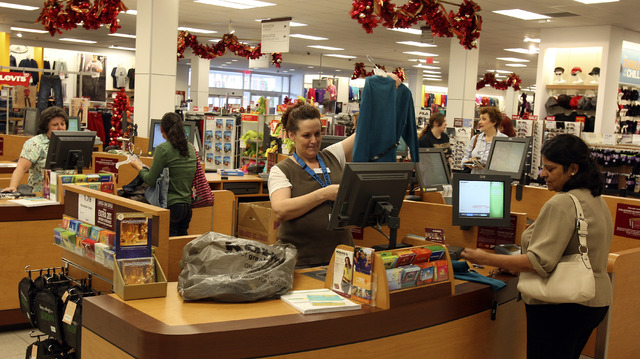 A shopper makes purchases at a checkout counter at Kohl's department store in the Galleria at Sunset mall on Friday, Nov. 19, 2010, in Henderson. (File, JOHN GURZINSKI/LAS VEGAS REVIEW-JOURNAL)