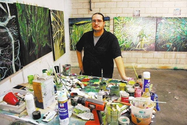 "Sean Russell works in his southwest Las Vegas studio. Russell's ""Unanimous Decision,"" a show based on his sunrise walks at Clark County Wetlands Park, is scheduled to be on display at the Wi ..."