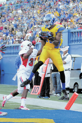 San Jose State wide receiver Tyler Winston (15) catches a touchdown pass over Fresno State defensive back Jonathan Norton (37) during the first half of an NCAA college football game on Friday, Nov ...