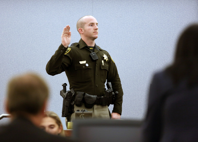 Las Vegas Metro Police Officer Benjamen Cobb (CQ) is sworn in before testifying at Richard Martin Schlacta's trial in Judge Joseph Sciscento's courtroom at Regional Justice Center Thursday, ...