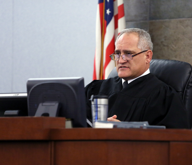 Judge Joseph Sciscento presides over Richard Martin Schlacta's trial at Regional Justice Center Thursday, Nov. 21, 2013, in Las Vegas. Schlacta, who is a California ex-convict, was charged with se ...