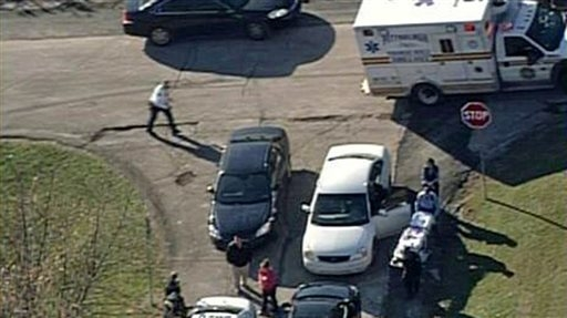 In this image provided by KDKA- TV emergency personal respond to a shooting at the scene near  Brashear High School, Monday, Nov. 13, 2013, in Pittsburgh. Pittsburgh police reported Monday that th ...