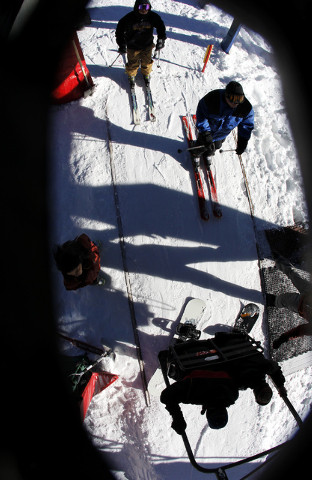 A pair of snowboarders load onto one of the first chairs of the year during opening day at the Las Vegas Ski & Snowboard Resort on Mount Charleston on Nov. 29, 2013. (Jason Bean /Las Vegas Review- ...