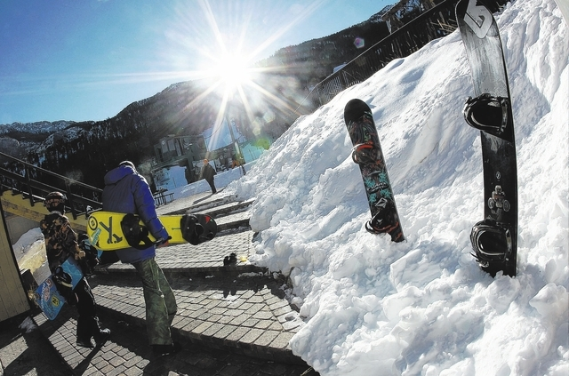 A pair of snowboarders head up to get in the early morning lift line during opening day at the Las Vegas Ski & Snowboard Resort on Mt. Charleston on Nov. 29, 2013. (Jason Bean /Las Vegas Review-Jo ...