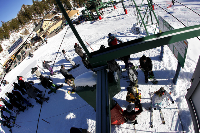 Riders get their tickets checked while waiting to load onto the chairlift during opening day at the Las Vegas Ski & Snowboard Resort on Mount Charleston on Nov. 29, 2013. (Jason Bean /Las Vegas Re ...