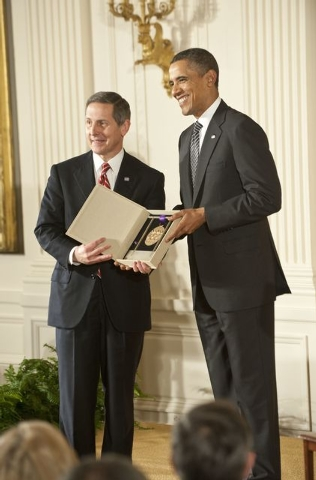 President Barack Obama presents  Sloan Gibson, President of the United Service Organization (USO), the 2011 National Medal of Arts President Barack Obama presents the 2011 National Medals of Arts  ...