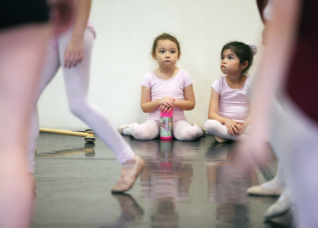 """Elliot Lavine, 5, center left, and Mya Gaston, 6, watch fellow dancers during a rehearsal of """"The Nutcracker"""" at the Las Vegas Ballet Company, Nov. 23. The two will be dancing as mice in the b ..."""