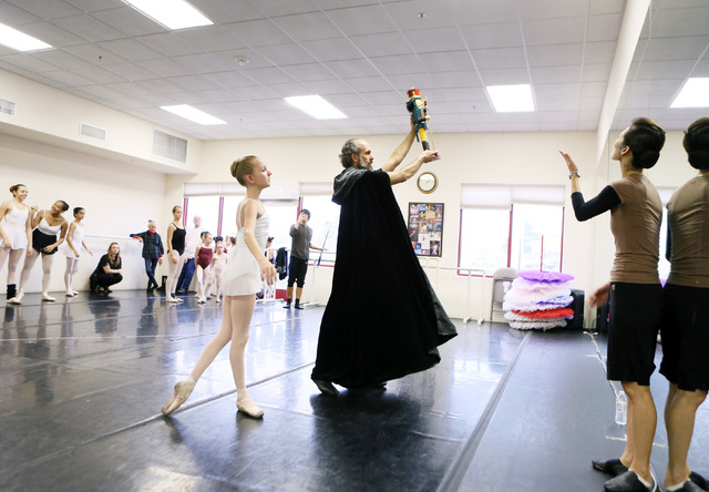 """Casy Vanden Berghe, left, and Mark Warden, center, perform under the direction of Yoomi Lee, right, during a rehearsal of """"The Nutcracker"""" at the Las Vegas Ballet Company, Nov. 23. Performance ..."""