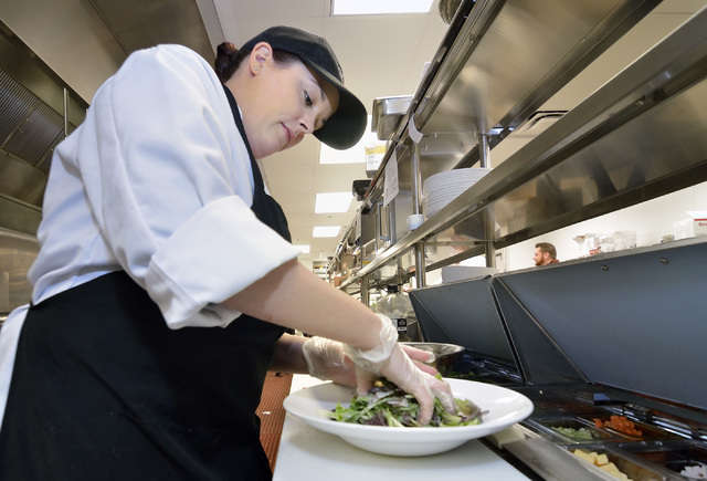 Melissa Rowe prepares a salad in the kitchen of the Stewart + Ogden diner bistro in the Downtown Grand . (Bill Hughes/Las Vegas Review-Journal)