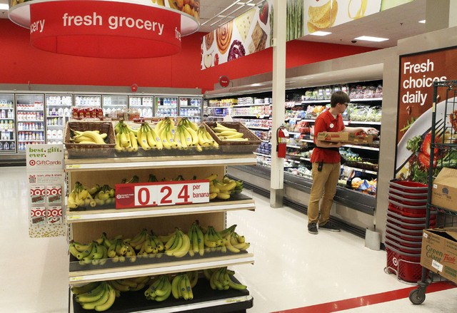 Perishables assistant Matthew Shaw restocks the fresh strawberrie at the Target on north Tenaya Way in Las Vegas, Thursday, Nov. 14, 2013. (Jerry Henkel/Las Vegas Review-Journal)