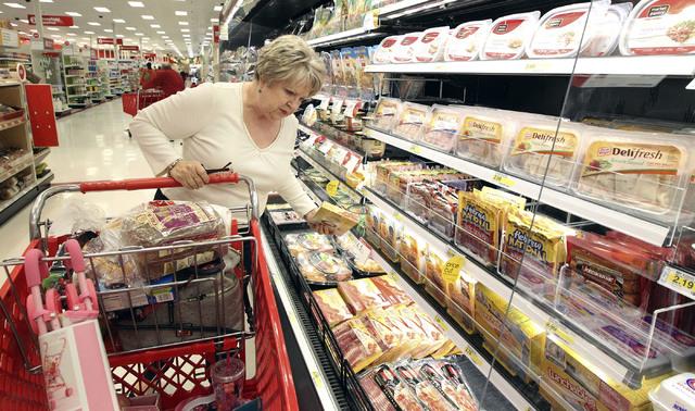 Darlene Goldstein, of Las Vegas, picks up some bacon at the Target on north Tenaya Way in Las Vegas, Thursday, Nov. 14, 2013. (Jerry Henkel/Las Vegas Review-Journal)