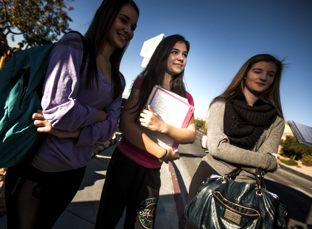 Coronado High School students Kenzie Hoopes, from left, Lauren Vermes and Sydney Shaw stand in front of the school  at  Coronado Center Drive, near Horizon Ridge Parkway in Henderson on Wednesday. ...
