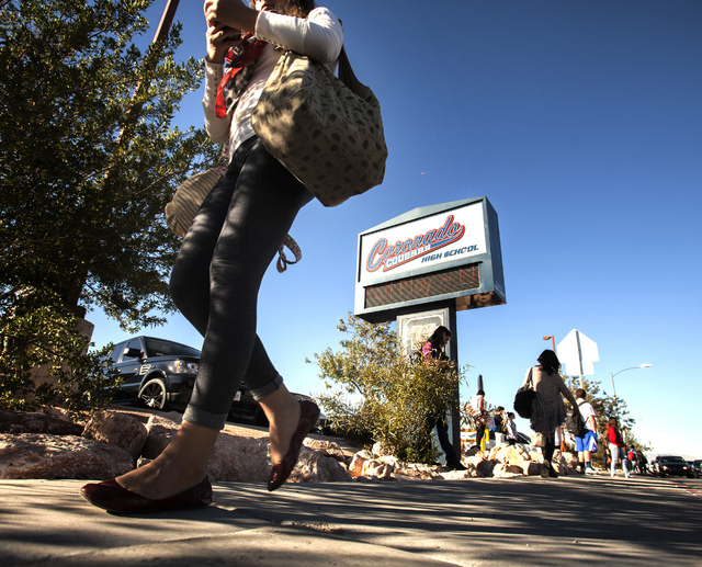 Students walk in front of  Coronado High School at Coronado Center Drive, near Horizon Ridge Parkway in Henderson on Wednesday. A student at the school has been diagnosed with contagious pulmonary ...
